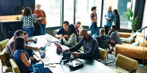 Digital Workplace and the digital transformation of work. People relaxed in the workplace.
